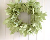 Green and white ribbon wreath
