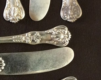 Ten Solid Sterling butterspreads or butter knives by Tiffany Co. English King pattern