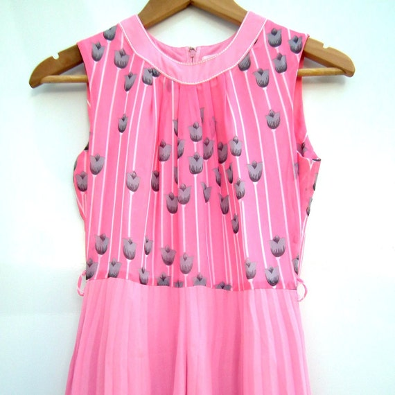 Pink dress adorned with flowers. Perfect outfit for sophisticated ladies. Perfect for spring!