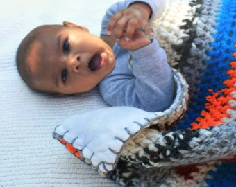 Crocheted hooded striped baby blanket with white lining orange blue white