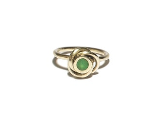 Silver ring with green agate gemstone in spiral