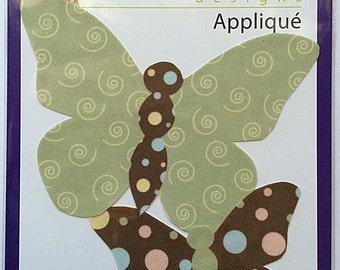 2 coordinating butterfly iron/sew on appliqués. Blue, pink and green polka dots. Light green swirls.