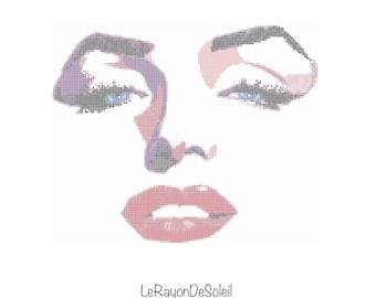 Cross stitch pattern Marilyn Monroe portrait art red lips blue eyes black eyelashes.