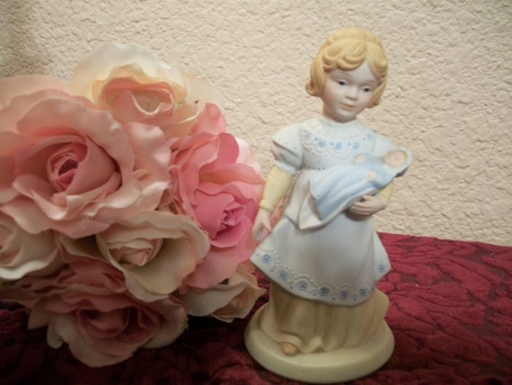 Girl with baby doll porcelain figurine a mother s love by