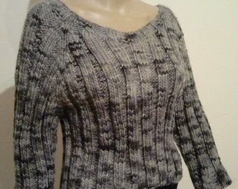 Knitted sweater from hand-dyed wool in grey