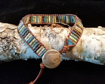 Earth Tones and Silver, Checz Picasso Bugle and Seed Beads Come Together To Create This Leather Wrap Bracelet.