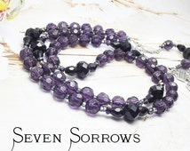 SEVEN SORROWS Chaplet with Pardon Crucifix in shades of Amethyst and Jet Black beads.
