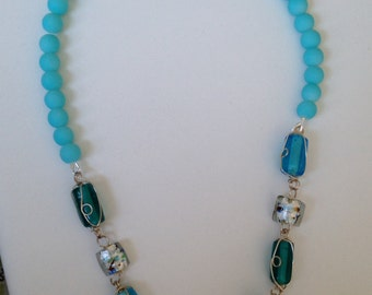 Turquoise glass stone necklace.