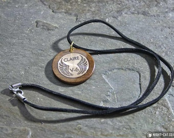 Dominion Citizen of Vega hardwood pendant or brooch with bronze or steel