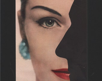 Vogue magazine ad featuring a red-lipsticked woman and a man's silhouette, matted - Beauty0263