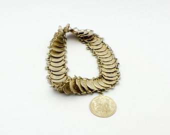 Silver Peso Bracelet with Mexican Pesos lined up and Linked Together into a Sterling Silver Bracelet