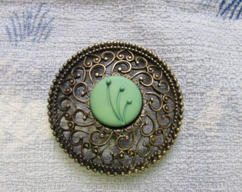 Hand-made gold-tone filigree round brooch, with contrast central green Art Deco button detail