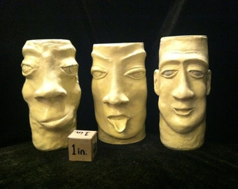 """Sculpted face on tin can. painted off-white""""Mona Louie"""""""