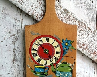 cutting board wall hanging with clock and tea pot vintage