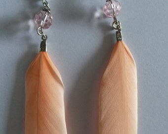 Salmon feather earrings with a pink bead, long dangling earrings