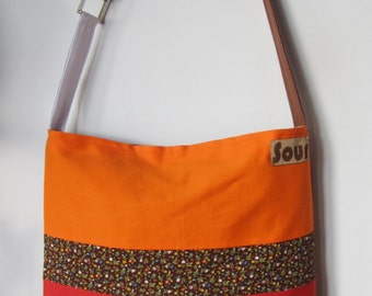 ON SALE// Away We Go Burnt Orange, Brown Floral and Bright Orange Sling Tote Bag with upcycled belt buckle