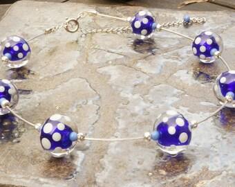 Dark blue and light green polka dot handmade lampwork glass bead choker length necklace