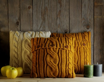Mustard yellow cable knit pillow cover with 3 wooden buttons.