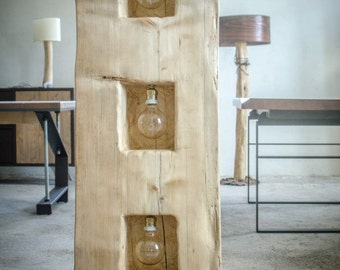 half spruce trunk tree with metal base and edison lamps