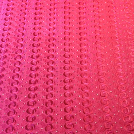 Fuchsia eyelet spiral embroidery fabric from