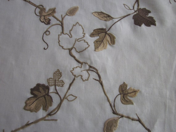 Drapery fabric brown and tan embroidered leaves design