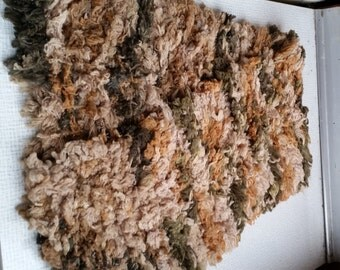 """Multicoloured scarf in creamy, brown, green colours. Looks like a """"fur""""."""
