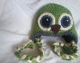 Child size crochet owl hat with adorable long braids.  Perfect for anyone to stay trendy in the cold weather.