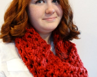 Cowl neck scarf in a deep red.