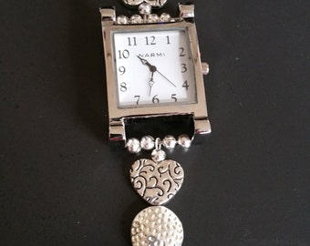 "Sweet, sentimental silver plated beads with lots of texture.  Watch face is 2"" by 1.25"" and the band measures about 7.25 inches."