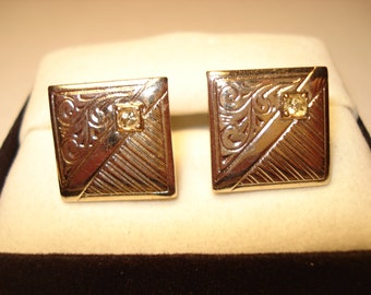 293--Silver tone scroll cufflinks with clear stone setting in corner of square
