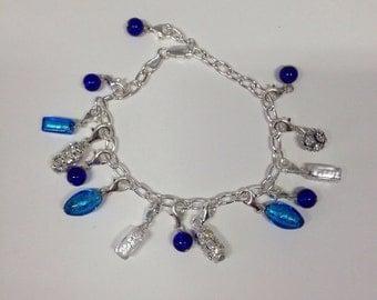Bracelets: silver bracelets with glass charms.