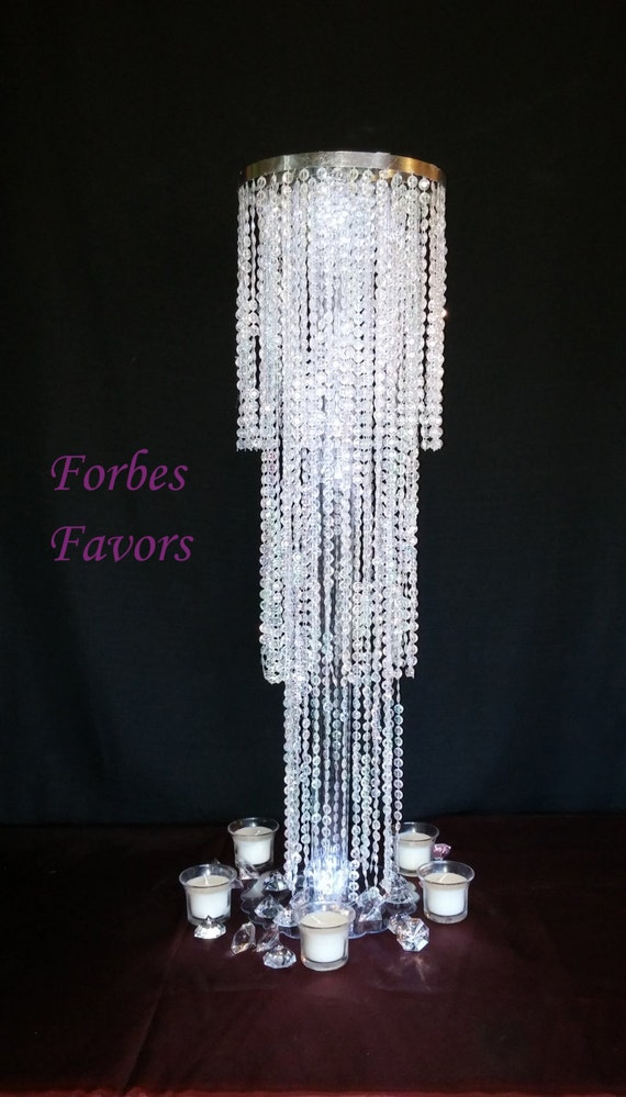 Exquisite chandelier centerpiece with riser by forbesfavors