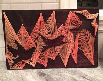Flying birds string art