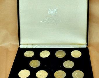 "Set of 13 Eisenhower dollars 1971 - 1978, Original box 10 1/2"" x 9"". - (1411-74)"