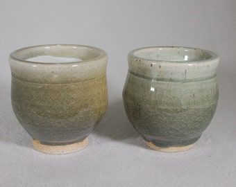 A pair of jade colored stoneware tea bowls