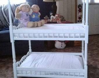 Custom handmade and painted wooden doll bunkbeds that can be used as separate single beds.