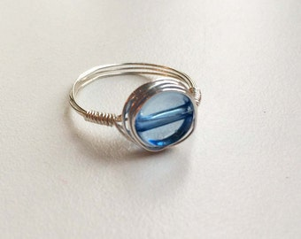 Silver wrapped ring with blue flat bead