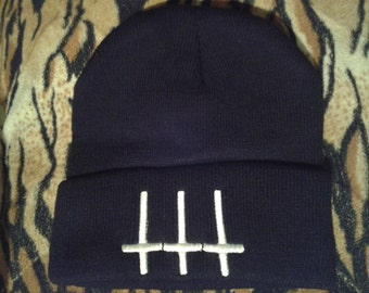 inverted cross beanie