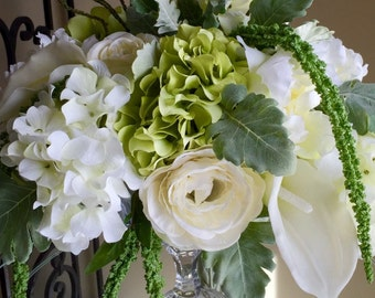 White and green hydrangea with Calla lilies, roses and dusty miller  floral arrangment centerpiece