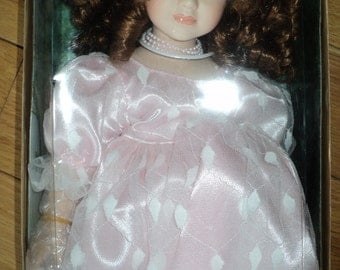 Pretty in Pink Seymour Mann Porcelain Doll, From the  Connoisseur Collection Doll in the original box with hand finished costume, very fine