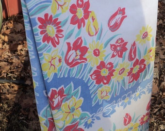 Vintage Tablecloth with primary color floral design display in Vintage Condition
