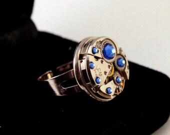 Design ring from vintage mechanical watch adding blue sapphire SWAROVSKI® crystals