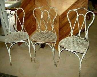 three ancient iron chairs