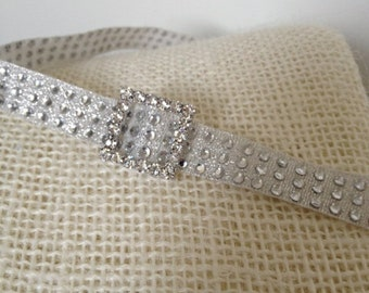 Sparkly infant headband is the perfect dressy touch for baby. Christening, baptism, weddings, photos...