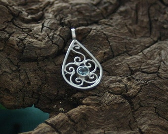 filigree worked, drop shaped spiral pendant with set blue topas - lovely made in silver