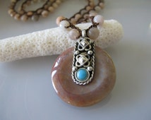SOLD! Artisan boho handwoven necklace of faceted sunstones and an agate disc with Tibetan bale