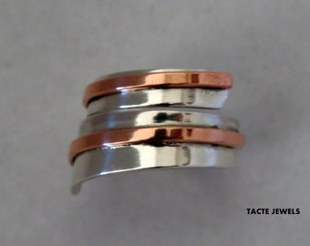 Silver ring spiral with a copper or brass wire