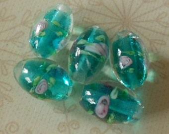 A pack of 5 lampwork glass beads, aqua barrel