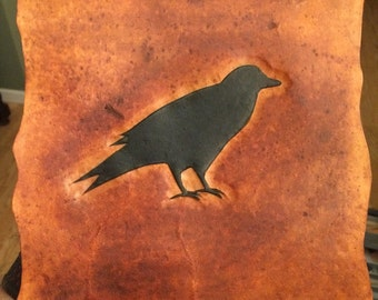 Rustic leather tooled crow