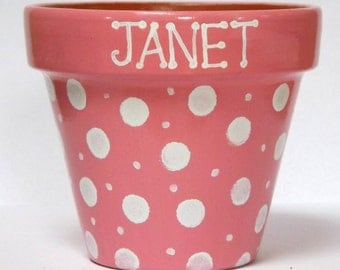 Hand painted terracotta personalised polka dot plant pots. 12 x 13.5cm.